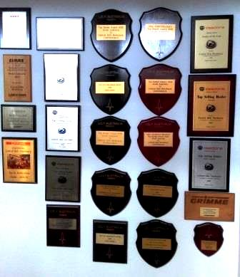 A small selection of accolaides Tony Cross has achieved over the many years selling agricultural machinery.